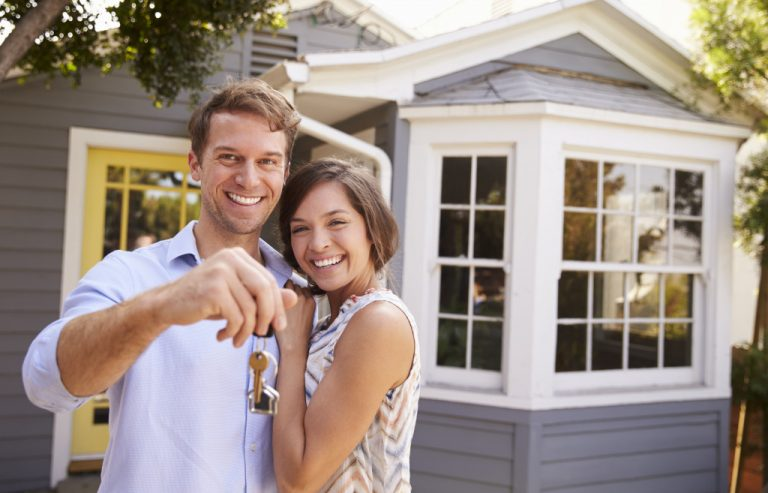 man and woman buying house